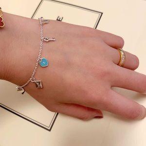 Tiffany & co silver charm bracelet